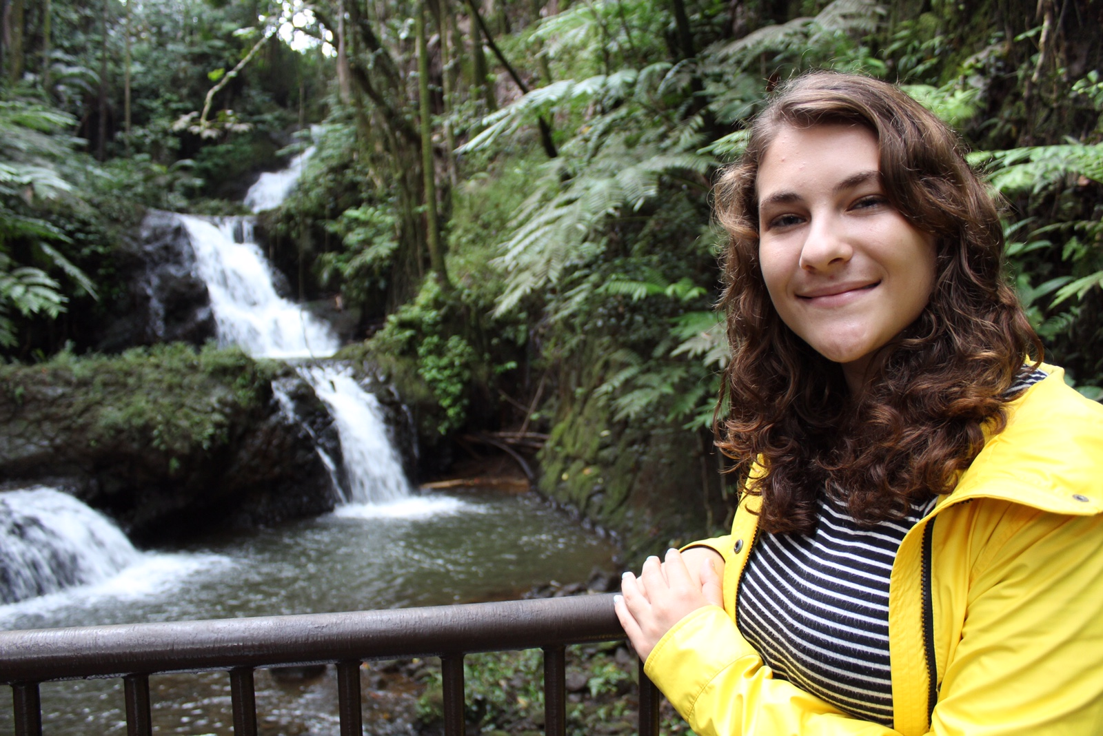 Gina smiling in front of a water fall