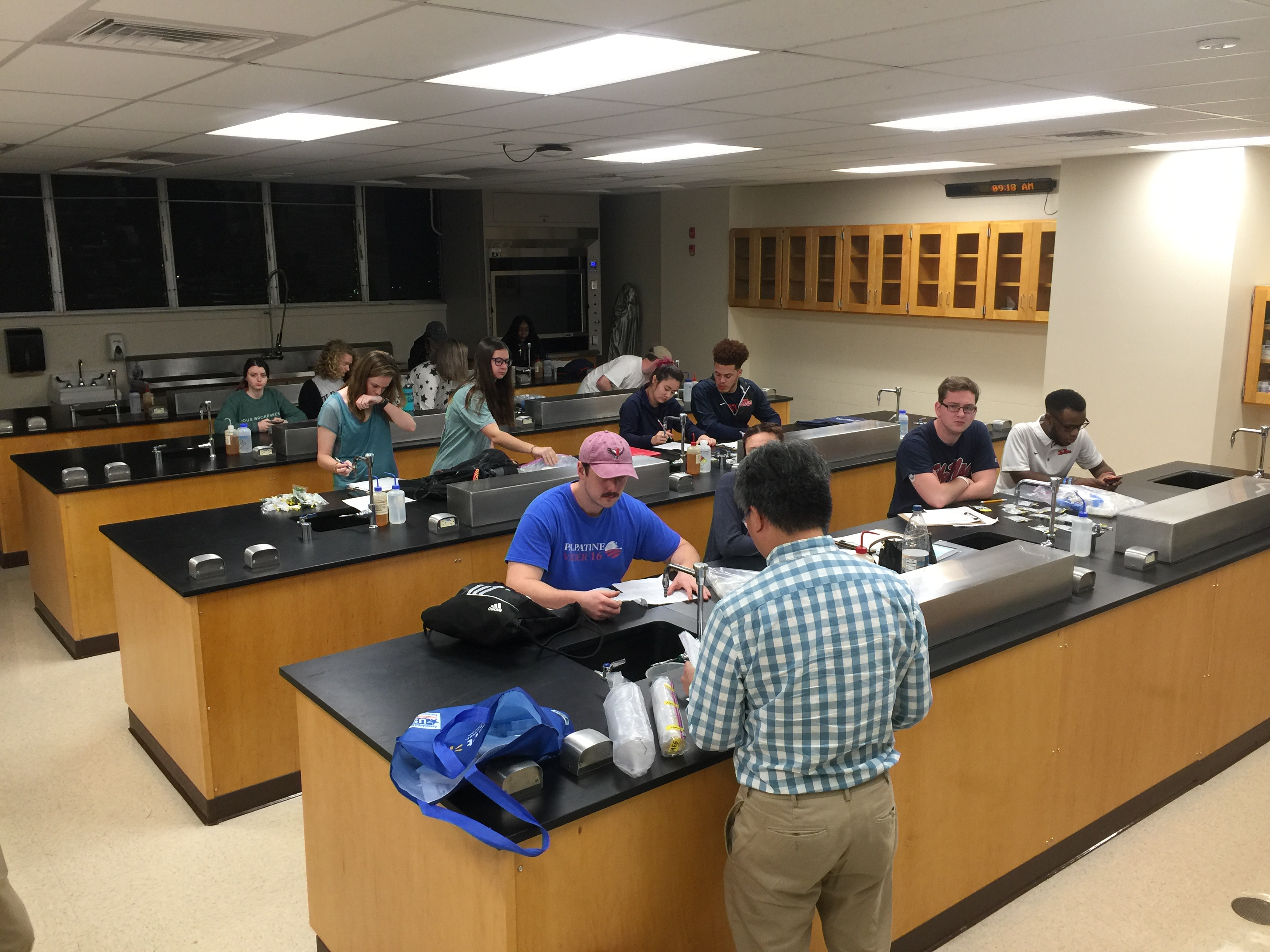 Students and faculty in lab conducting research on tissue sampling