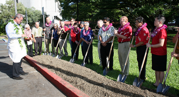 Group of dignitaries with shovels.