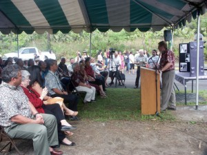 UH Hilo Chancellor Straney at podium speaking to crowd at groundbreaking ceremonies.