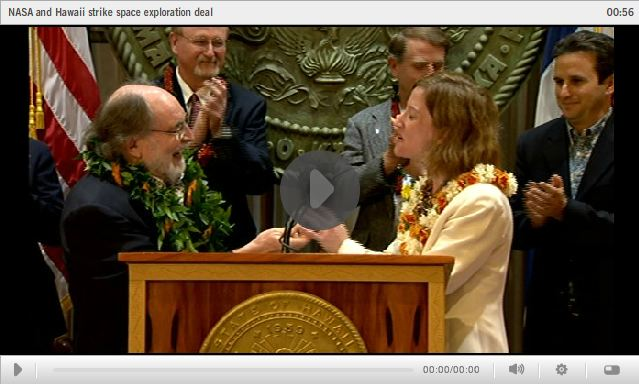 Video screen grab of Governor Abercrombie and guest at bill signing