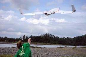Chuck Devaney hand launching an X8 UAV for flight.