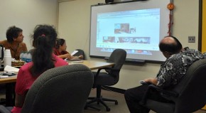 Group participates in video conference.