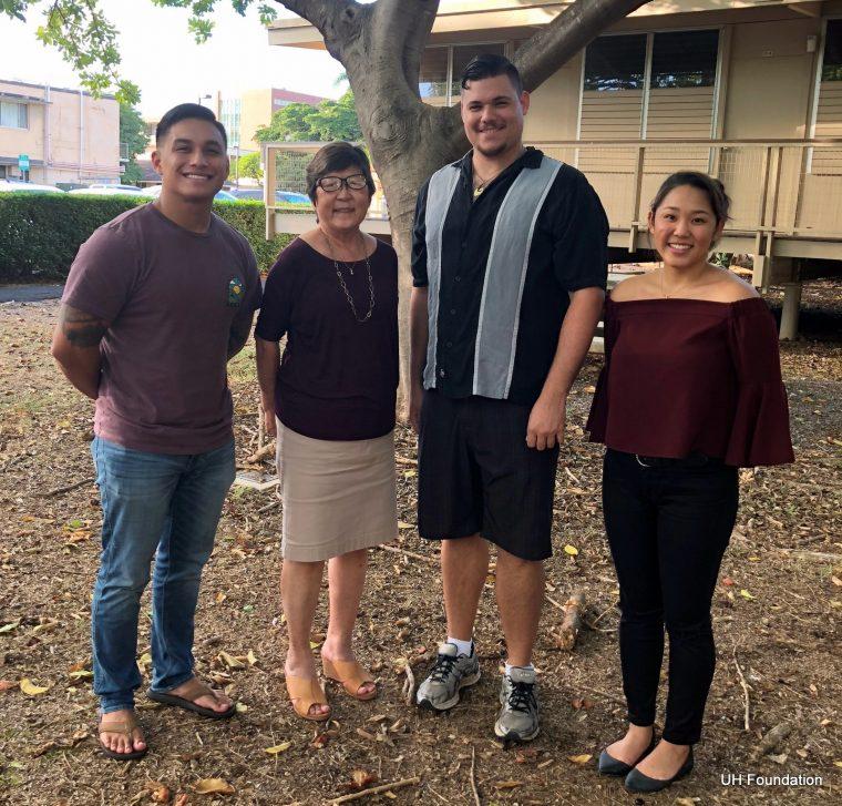 Marcia Sakai and three students stand under tree.