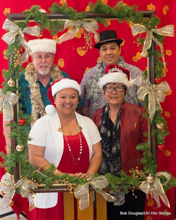 Marcia Sakai, Farrah-Marie Gomes,, Ken Hon, and Kalei Rapoza in Santa hats.