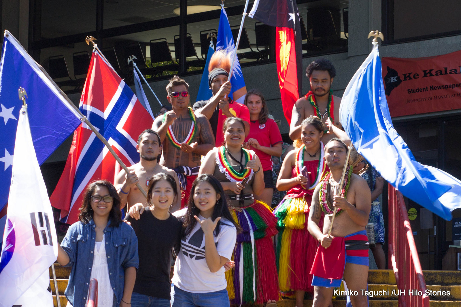 Parade of Nations, students on steps of Campus Center, national flags.