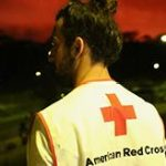 Red Cross worker at lava flow