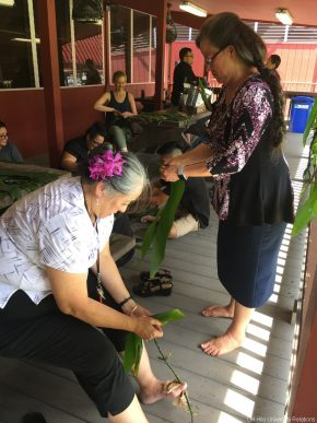 Staff members make ti lei.