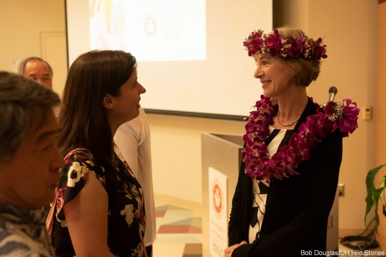 Jennifer Doudna greets attendee.