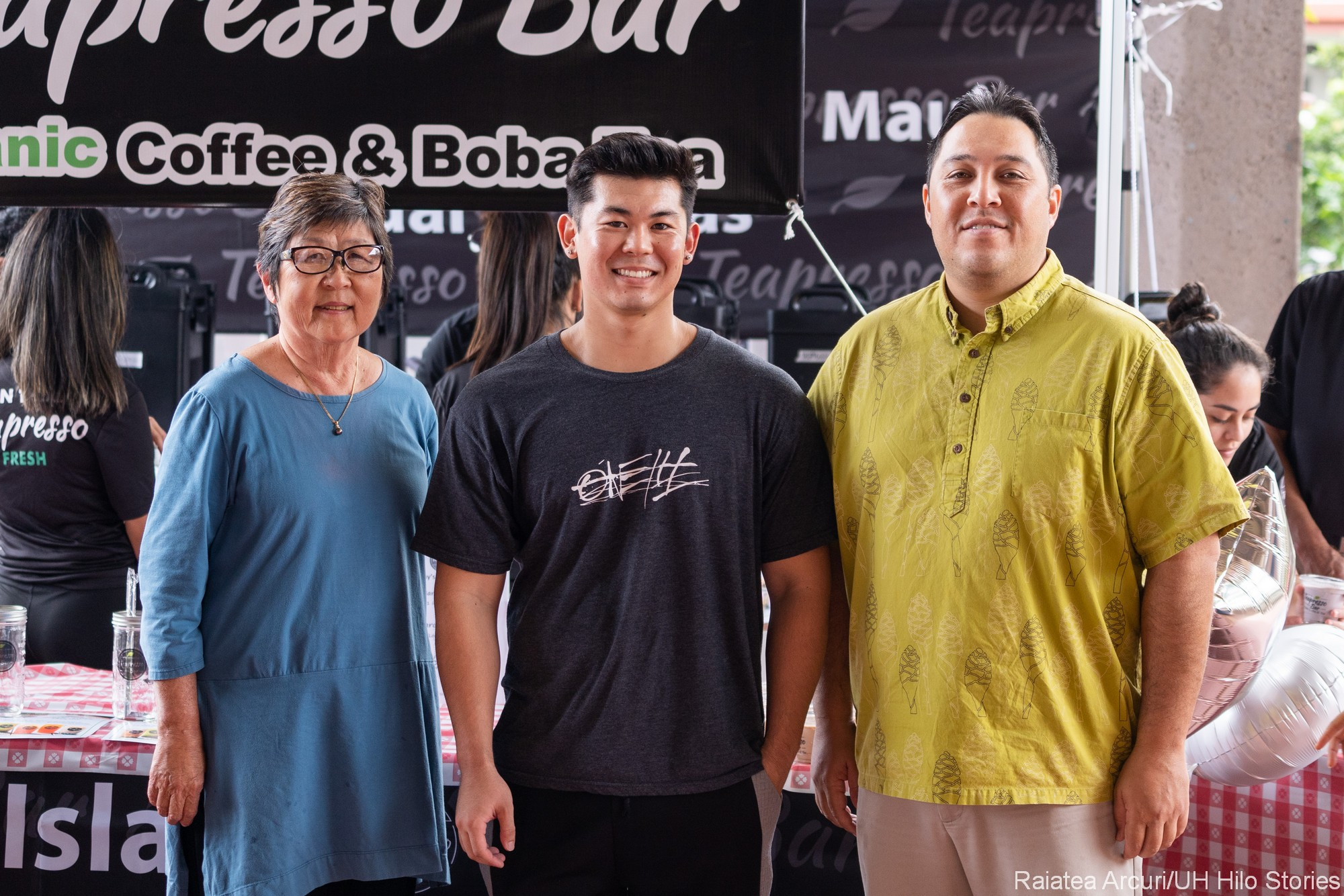 Marcia Sakai, Jordan Kamimura, and Kalei Rapoza standing in front of the Teapresso concession.