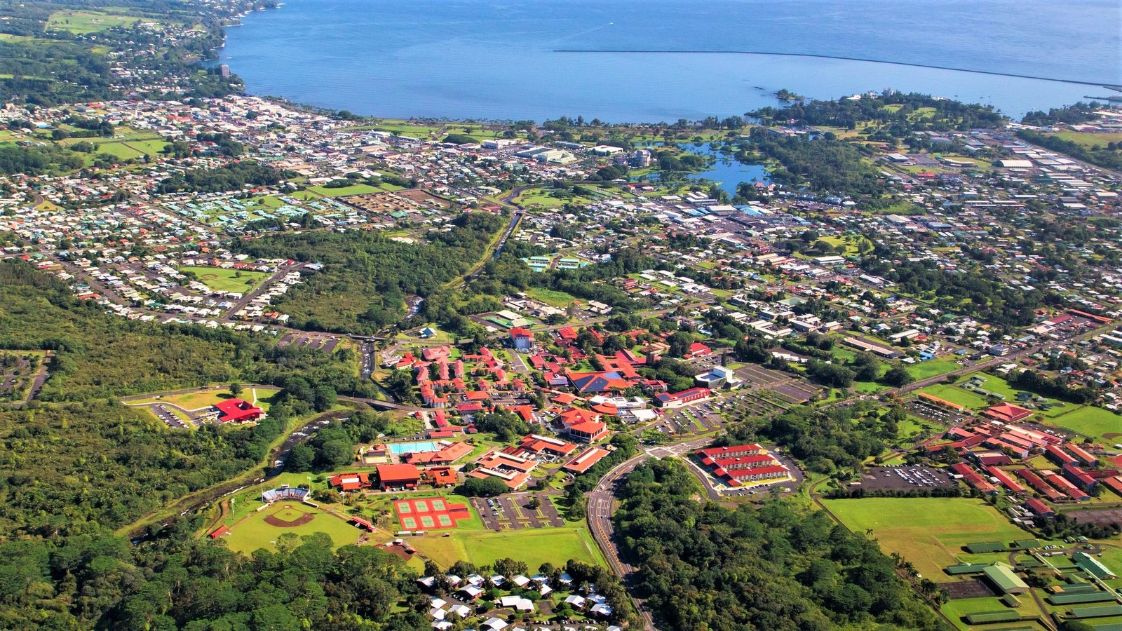 Aerial of the campus and community with Hilo Bay.