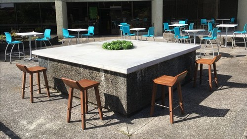 Outdoor seating with 6-foot spacing.