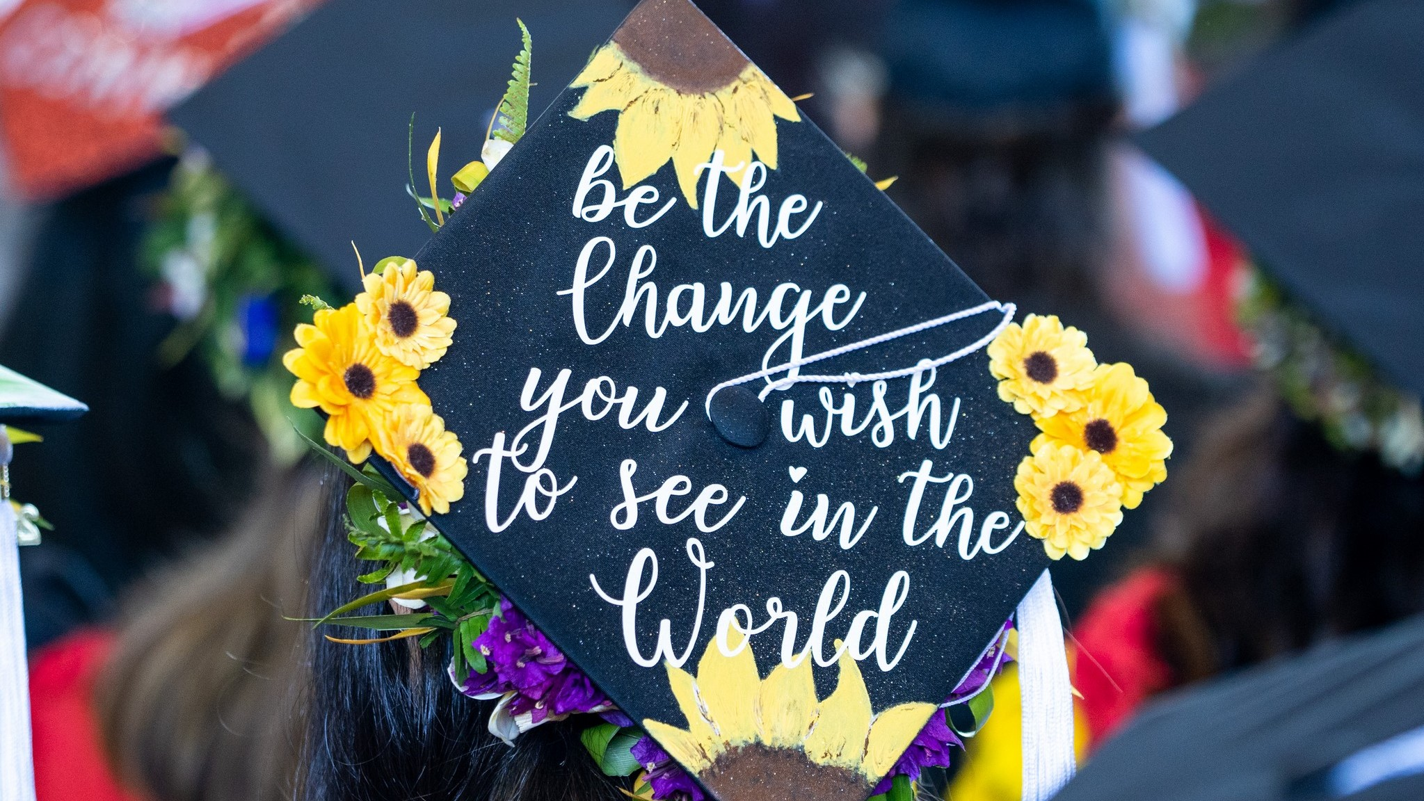 Mortarboard with wrods: Be the chancge you wish to see in the world.