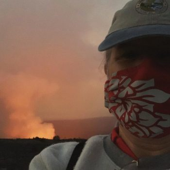 Chancellor Irwin with eruption plume in background.