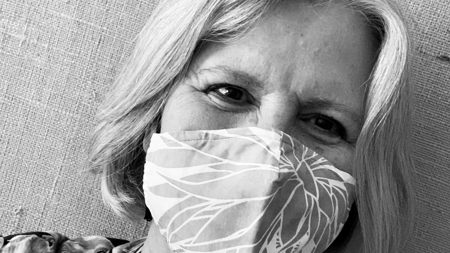 Bonnie Irwin wears a mask