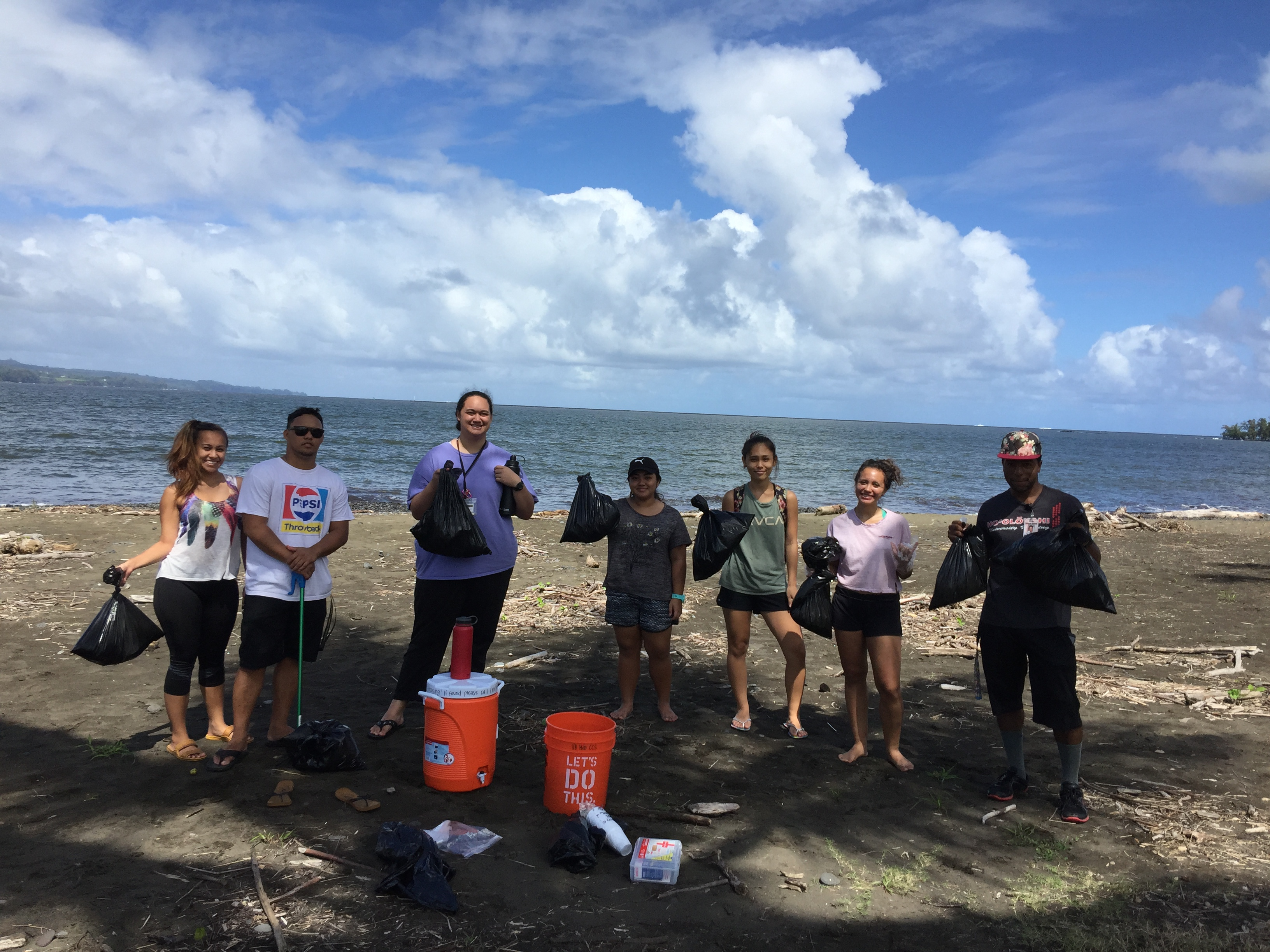 A group of students working on a beach clean-up service project