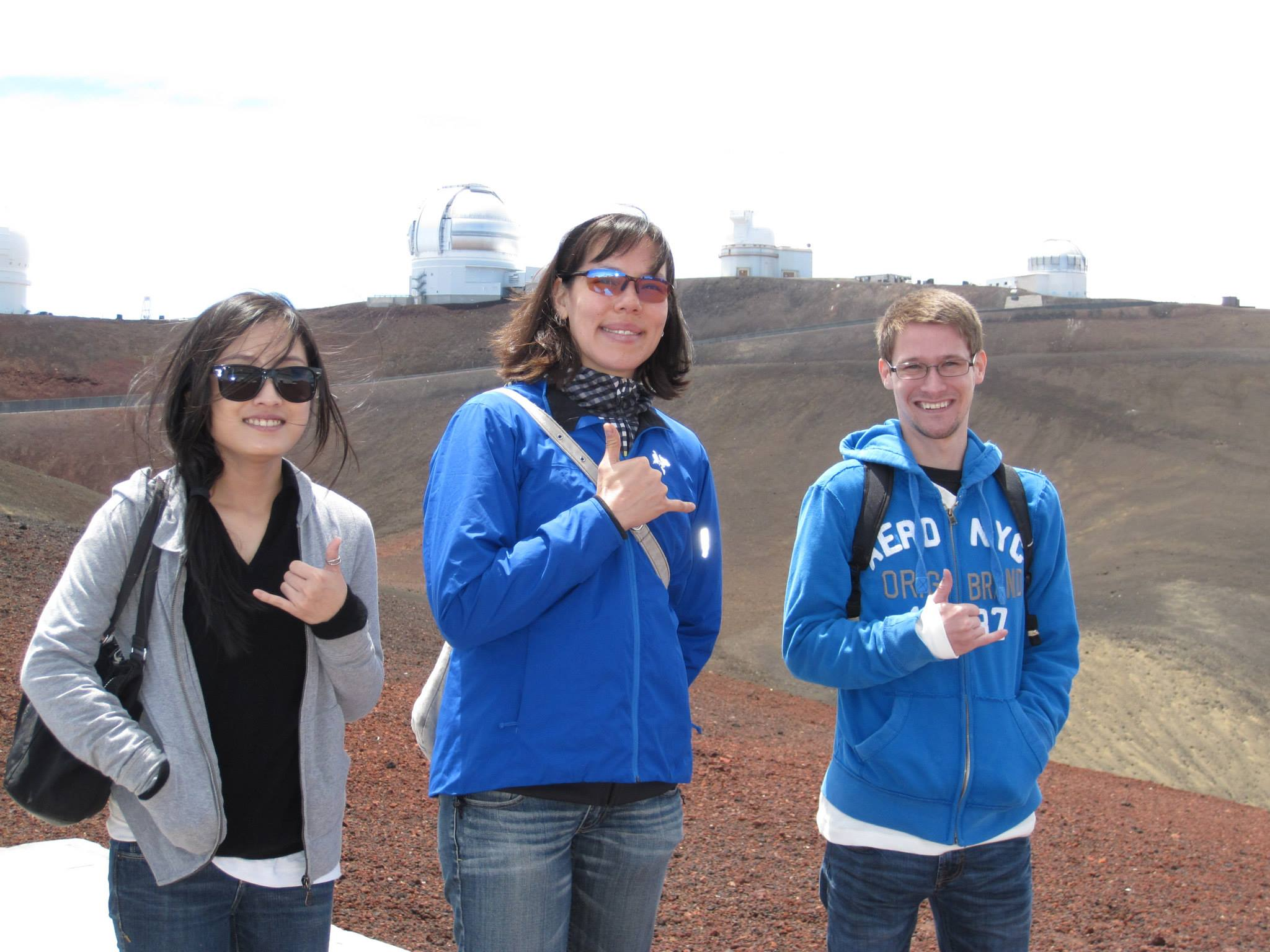 Kathy and her two students flash the shaka with observatories in the background.