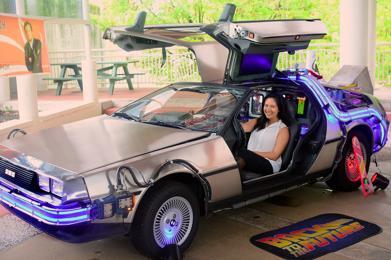 Megan Araujo sits in Back to the Future DeLorean parked on the Campus Center Plaza.
