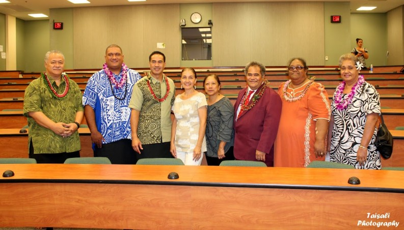 Samoan delegation with officials from UH Hilo pose for photo in lecture hall.
