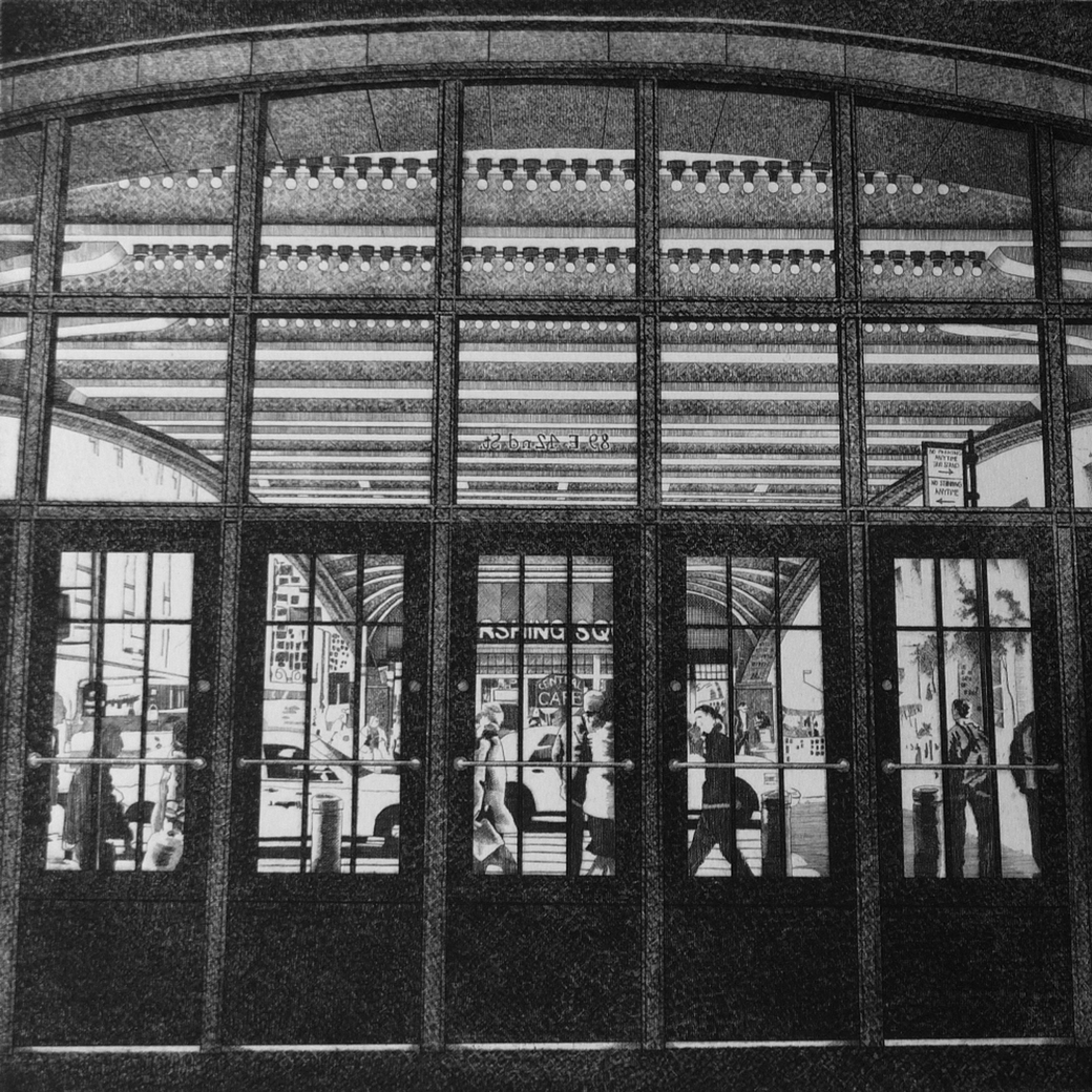 Entrance way to large building, with arches and glass doors.