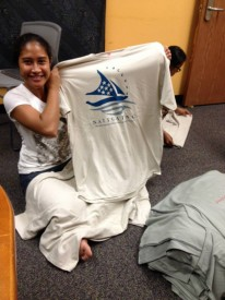 Team Leader Josie showing off the participants' uniform. — at Pacific Islander Student Center at UH Hilo.