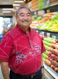 Barry Taniguchi in produce section of his grocery store.