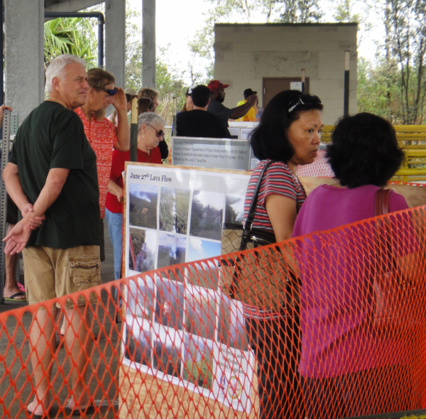 Crowds shows visitors enjoying the views and posters under the Transfer Station roof