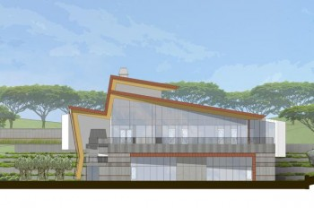 Rendering of the pharmacy building. Glass walls, red roof.