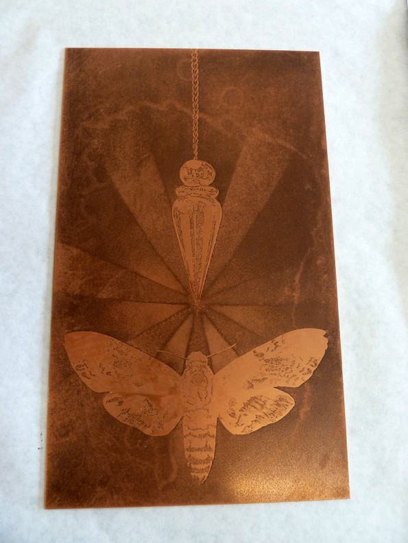 The plate of pendulum hanging over moth.