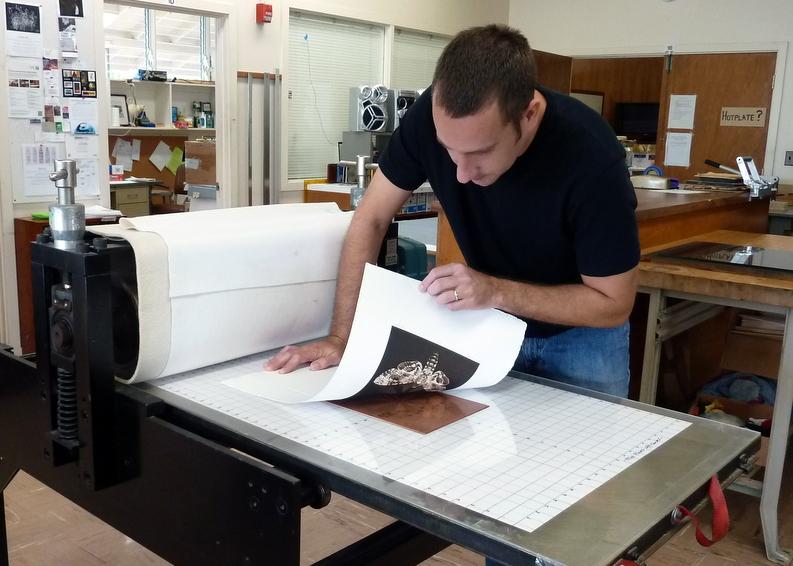 Goebel peels back the print form the copper plate.