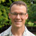 Ryan Perroy, aloha shirt, glasses, smiling at camera.