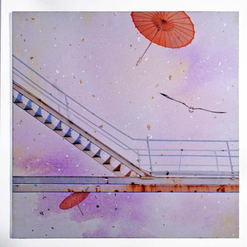 Umbrellas floating in the sky.