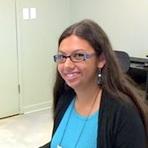 Tehani Palolo seated at desk.