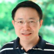 Head image of Supakit Wongwiwatthananukit, in striped shirt.