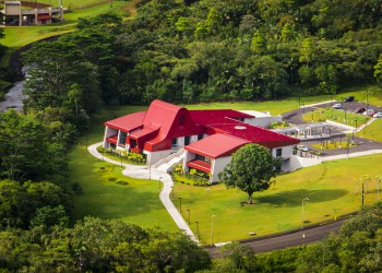 Haleʻōlelo aerial shot, green curved roof , surrounded by green forest.