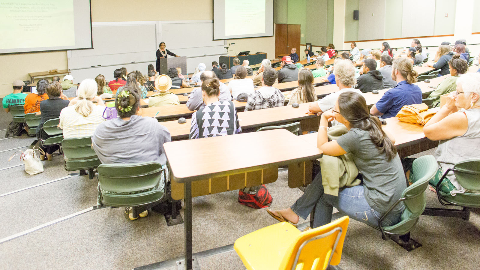 Ngahiraka Mason speaks to students in tiered lecture hall.