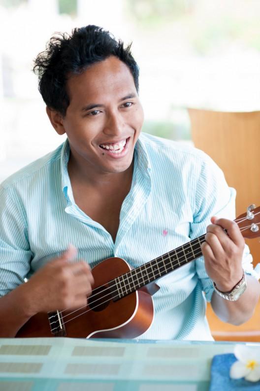 Matthew Theirren playing ukulele.