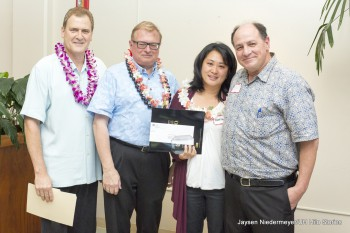 Nadine Hara stands with UH Hilo officials for photo. She holds certificate.