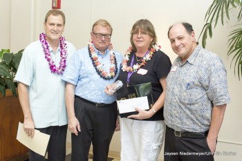 Susan Jarvi stands with UH Hilo officials for photo.