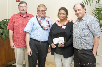 Davelyn Cruz stands with UH Hilo officials for photo. She holds certificate.