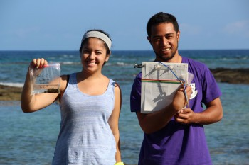 UH Hilo PIPES summer 2015 interns collect seaweed samples along the Puakō coastline for detection of sewage pollution. (l-r) Belytza Velez from the University of Puerto Rico, and Byran Tonga from the UH Hilo marine science program.