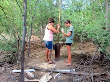 Collecting groundwater samples from a well in Puakō are Leilani Abaya, UH Hilo marine science alumni and Tropical Conservation Biology and Environmental Science graduate student, and Kaile'a Carlson, project technician, UH Hilo TCBES alumni.