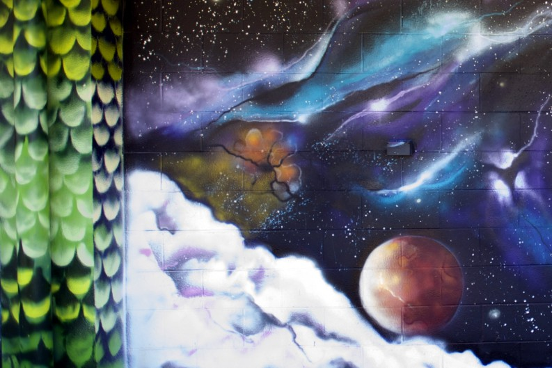 Detail of a wall with planets and constellations.