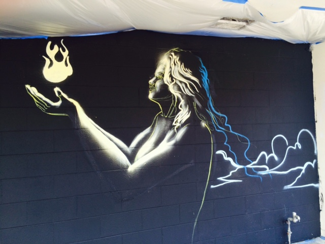 An image on the mural of a woman holding a flame.
