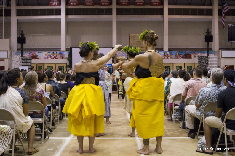 Dancers in yellow and black enter venue.