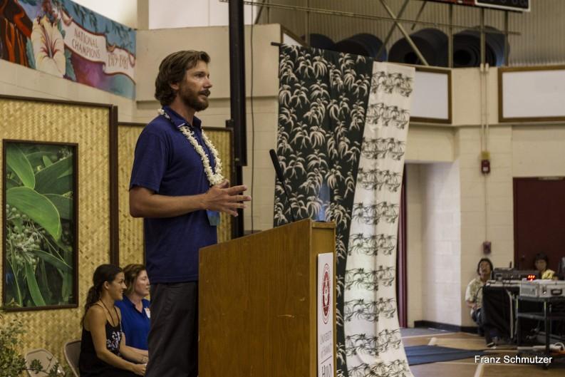 Male speaker at podium.