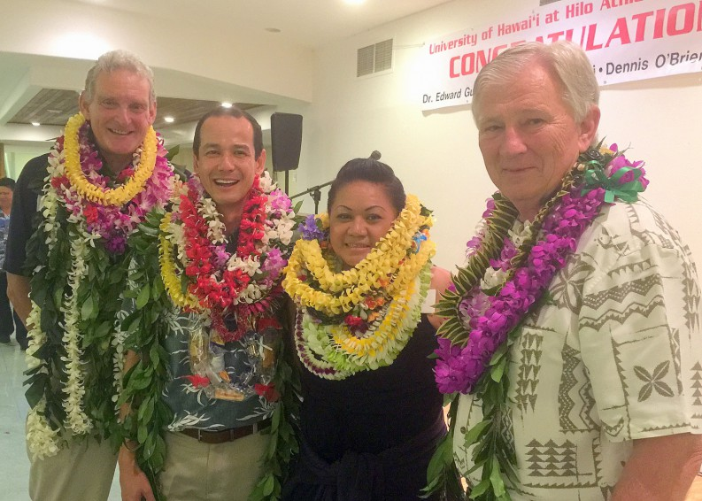 Each with many lei: Edward Gutteling, Flavio Nucci, Edna Togiai, and Dennis O'Brien stamd together for photo.