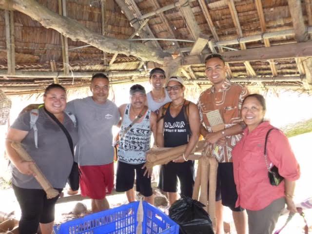 (l-r) Ākeamakamae Kiyuna, Larry Raigetal, Project Coordinator with Waaʻgey, Kealiʻi Reichel, Holo Hoopai, Taupōuri Tangarō, Hanalei Marzan, and Gail Makuakāne-Lundin at the Yapese Living History Museum, Colonia Yap.