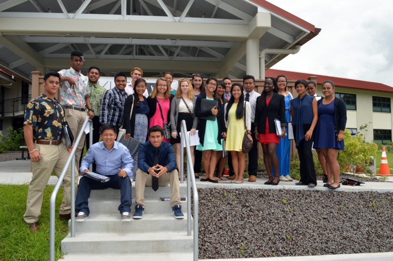 Group photo of students in casual business attire.