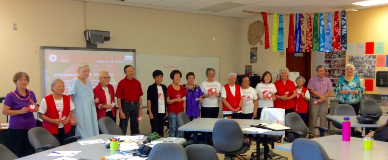 Line of retired teachers at the head of the class.